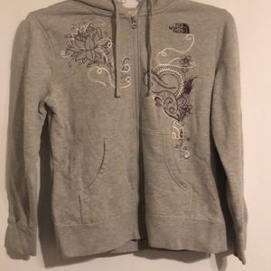 North Face hoodie with purple and white design.